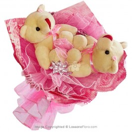 2 Teddies in a bouquet with pink wrapping
