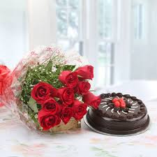 1 Kg Theobroma Dutch Truffle Cake with 20 red roses bouquet