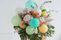 20 green yellow orange balloons with flowers and leaves green blue wrapping