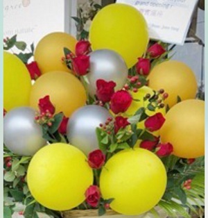15 yellow silver balloons arranged in basket with 15 red roses