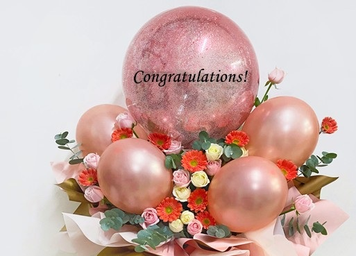 20 pink white flowers 4 small pink balloons and one large bobo balloons with confetti and Congratulations on balloon