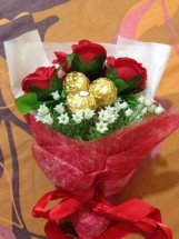 3 Red Roses with 5 ferrero in same bouquet in red wrapping