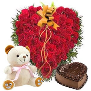 50 heart shaped roses, 1 kg cake and teddy bear