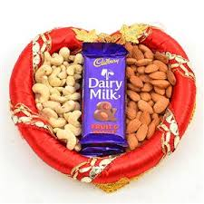 250 gms cashews 250 gms almonds with chocolates in a tray