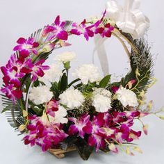 Arrangement of 6 white carnations 6 Purple Orchids on Handle