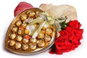 red roses bunch Heart shaped chocolate box
