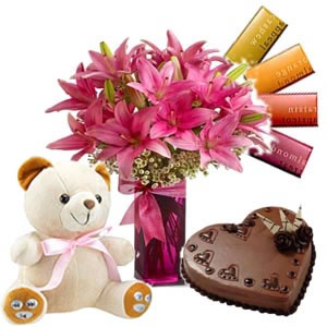 6 lilies vase with 4 temptation chocolates and 1/2 kg Cake and 6 inch teddy