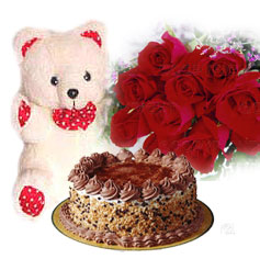 1/2 kg Cake with 12 red roses and teddy bear
