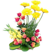 24 gerberas and gladioli in basket