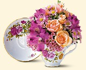 Tea cup arrangement with fresh flowers