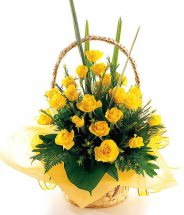 12 yellow roses in a basket