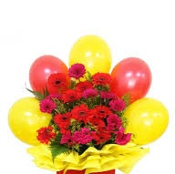 20 red gerberas with 5 red yellow balloons arranged in basket
