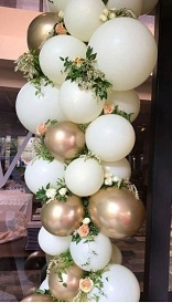 Gold white silver air balloons with flowers in between
