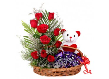 12 red roses 6 inch Teddy 5 dairy milk all in a basket