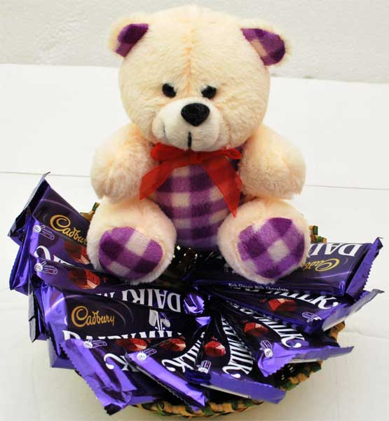 6 inch Teddy with 10 Dairy milk chocolates in basket